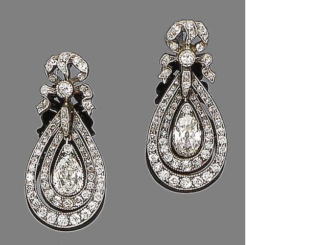 A pair of diamond pendent earrings,