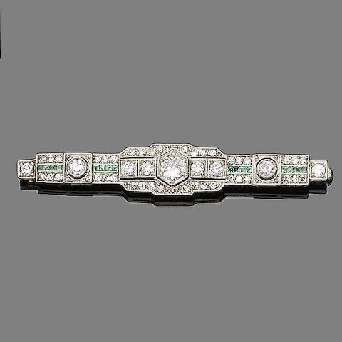 An art deco emerald and diamond bar brooch,