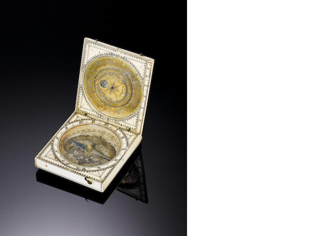 A 17th Century ivory housed sundial/compass,