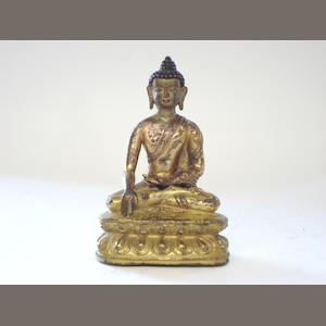 A gilt bronze Buddha Tibetan, 18th century