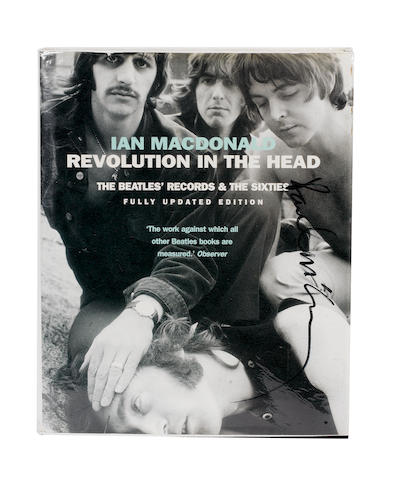 A copy of Ian MacDonald's 'Revolution In The Head' autographed by Paul McCartney,