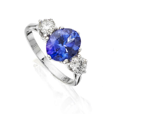 A tanzanite and diamond three-stone ring
