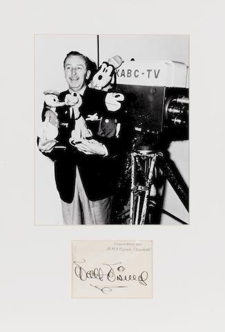 Walt Disney: An autographed R.M.S. Queen Elizabeth card,