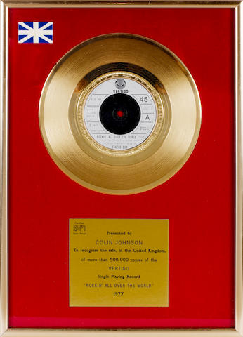 Status Quo: a 'Gold' sales award for the single 'Rockin' All Over The World', 1977,