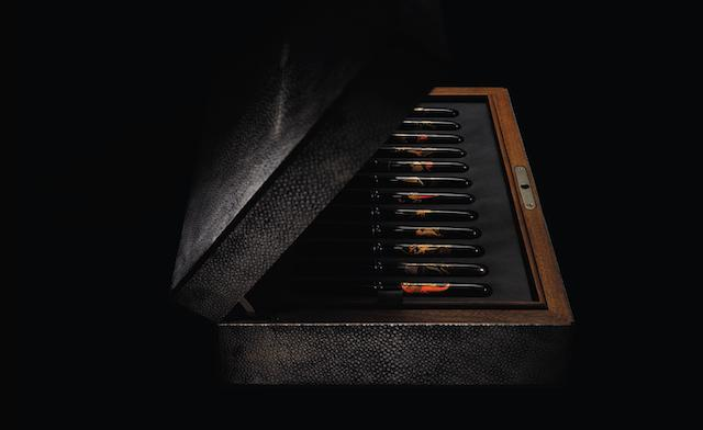 DUNHILL-NAMIKI: A uniquely compiled set of twelve Japanese Namiki vintage barrel pens, contained in a specially commissioned shagreen box,  barrels signed by identified maki-e artists,