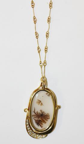 A moss agate and diamond pendant