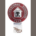 An International Doghouse Club car badge,