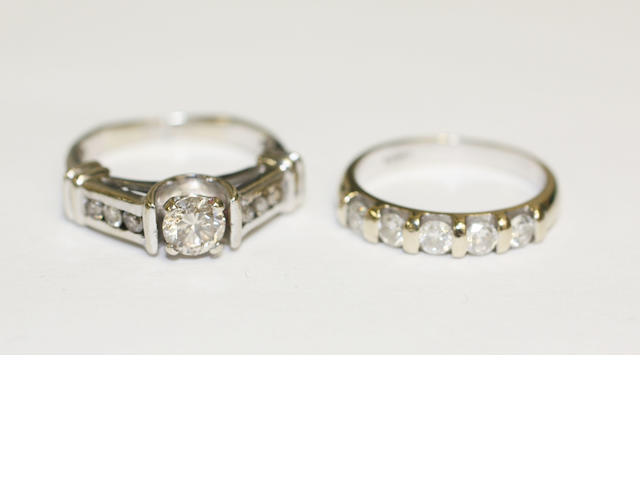 A single stone diamond ring and a five stone diamond ring