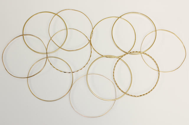 A collection of eleven slave bangles, (11)