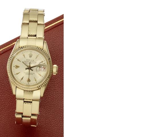 Rolex. A lady's 18ct gold automatic bracelet watch together with fitted box and chronometer certificateLady-Date, Ref:6517, Case No.448796, Sold 11th June 1960