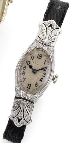 Rolex. A lady's 18ct white gold diamond set cocktail watch Glasgow Import mark for 1927, Case numbered 43258
