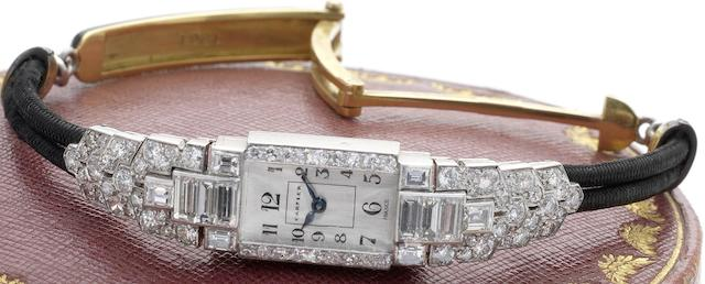 Cartier. A very and rare fine platinum and diamond set lady's cocktail watch Numbered 21064, Circa 1930