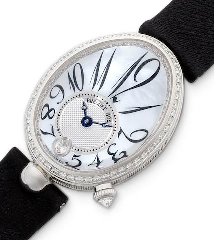 Breguet. A fine 18ct white gold and diamond set lady's wristwatch with mother of pearl dial and together with presentation box and papers Queen of Naples, Ref:8913, Case No.402AO, Movement No.0042523, Recent