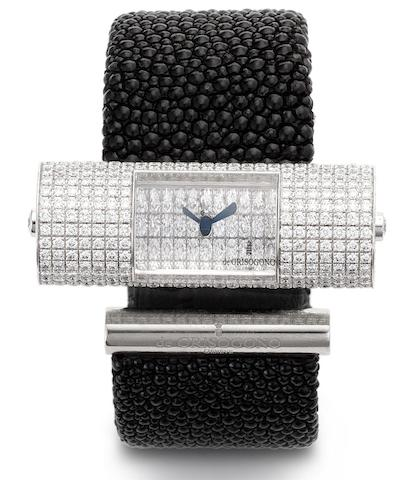 Di Grisogono. A lady's 18ct white gold and diamond set quartz bangle watch'Lipstick', Recent