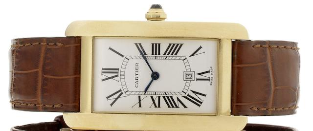 Cartier. An 18ct gold automatic calendar wristwatchTank Americaine, Recent