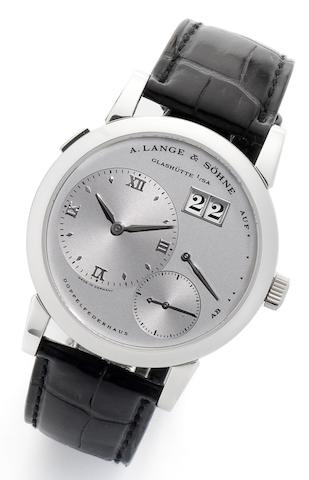 Lange & Söhne. A fine platinum manual wind calendar wristwatch with eccentric dial and large date aperture, together with presentation box, outer card and video cassette Lange 1, Model No.101.035, Ref:072/21816, Serial No.129958, Movement No.17376, Sold by Wempe 29th November 2000