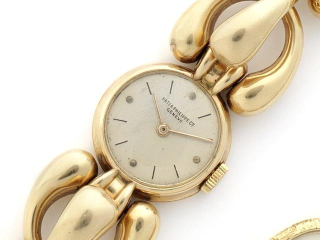 Patek Philippe. An unusual 18ct gold lady's bracelet watchCase No.642024, Movement No.941996, Circa 1955
