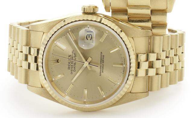 Rolex. An 18ct gold calendar bracelet watch together with box and papers Datejust, Ref:16238, Case No.L979792, Sold 8th July 1991
