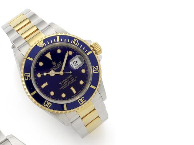 Rolex. A stainless steel and gold automatic calendar bracelet watch together with fitted Rolex box and papers Submariner, Ref:16613, Movement No. 5781917, Serial No. E619357, Sold 7th May 1991