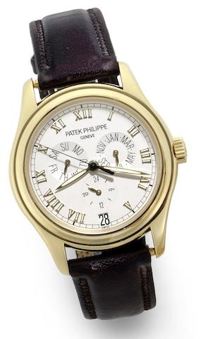 Patek Philippe. A fine 18ct gold automatic calendar wristwatch together with fitted Patek Philippe box Ref:5035J, Case No. 4252779, Movement No.3133766, Sold 14th of May 2004