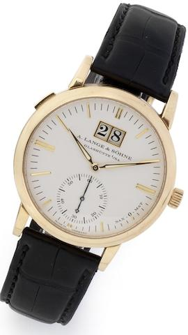 Lange & Söhne. A fine 18ct gold automatic calendar wristwatch Sax-o-Mat, Case No.134751, Movement No.23485, Recent