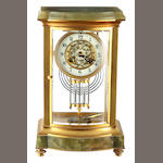 A French giltmetal and onyx four-glass clock