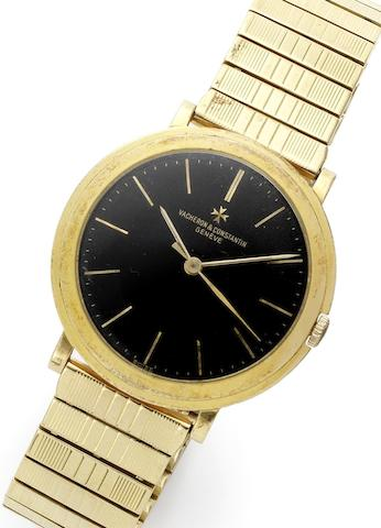 Vacheron Constantin. An 18ct gold manual wind centre seconds bracelet watch Ref:4986, Movement No.530541, Case No.355692, Circa 1960
