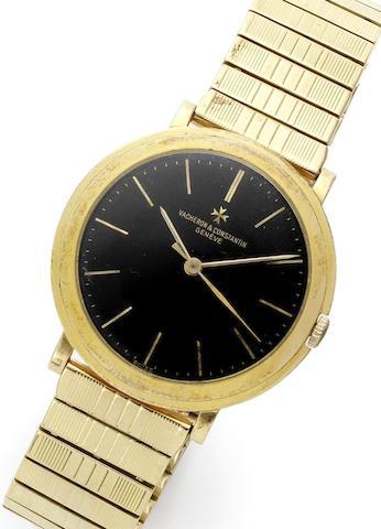 Vacheron Constantin. An 18ct gold manual wind centre seconds bracelet watchRef:4986, Movement No.530541, Case No.355692, Circa 1960