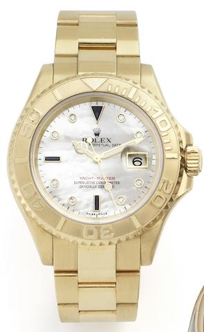 Rolex. An 18ct gold automatic calendar bracelet watch with mother-of-pearl dialYachtmaster, Ref:166288, Case No.F624709, Circa 2004