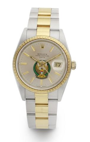 Rolex. A stainless steel and gold automatic calendar bracelet watch with special order dial with the UAE emblem Oyster Date, Ref:15223, Case No.X495179, 1991