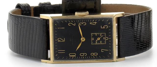 IWC. A fine and rare 14ct gold  black dial rectangular wristwatch 1930's