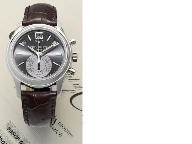 Patek Philippe. A fine and rare platinum automatic flyback chronograph annual calendar wristwatch with power reserve and day/night indication, together with fitted presentation box, Certificate of Origin and setting tool Ref:5960P, Case No.4457388, Movement No. 3503985, Sold 4th July 2009