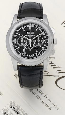Patek Philippe. A fine and rare platinum perpetual calendar chronograph wristwatch with leap year and moon phase indication together with a Patek Philippe box and Certificate of Origin Ref: 5970P, Case No. 4494977, Movement No.3931452, Sold 29th September 2009