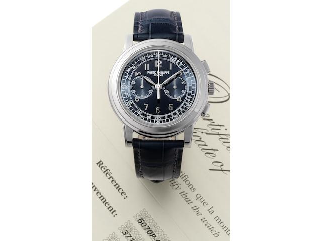 Patek Philippe. A very fine and rare platinum chronograph perpetual calendar wristwatch together with Patek Philippe box and Certificate of Origin Ref:5070P, Case No. 4457388, Movement No. 3503985,