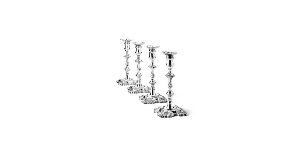 A set of four George II silver candlesticks By John Cafe, London 1748