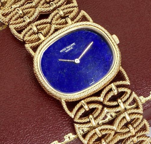 Patek Phillipe. A lady's 18ct gold manual wind bracelet watch with lapiz lazuli dial Circa 1970
