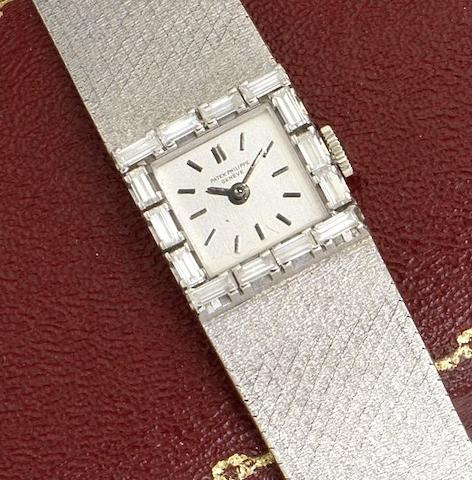 Patek Philippe. A fine 18ct white gold and diamond set manual wind bracelet watchRef:3313, Case No.2636598, Movement No.985117, Circa 1960