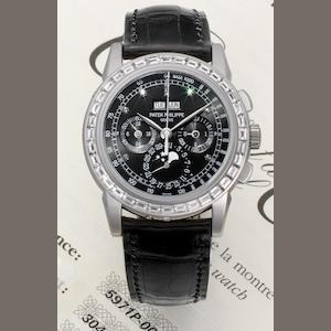 Patek Philippe. A very fine and rare platinum and diamond set perpetual calendar wristwatch together with spare case back, Certificate of Origin and setting tool Ref:5971P, Case No.4459007, Movement No.3049366, Sold 16th December 2008