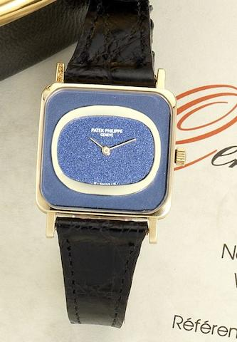 Patek Philippe. A lady's 18ct gold manual wind wristwatch together with box and Certificate of OriginEllipse, Ref:4183, Case No.2758153, Movement No. 1273131, Sold 30th of March 1977