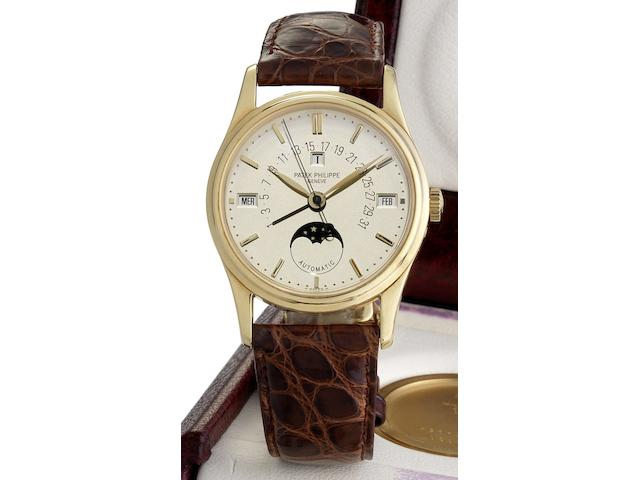 Patek Philippe. A fine and rare 18ct gold automatic perpetual calendar wristwatch with retrograde date, spare back, setting tool, Patek Philippe automatic winding box and Certificate of OriginRef:5050, Case No.2961785 Movement No.1957236, Sold May 1998