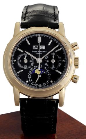 Patek Philippe. A very fine and very rare 18ct rose gold and black dial manual wind perpetual calendar chronograph wristwatch together with fitted Patek Philippe box, setting tool and Extract from ArchivesRef:3970E, Case No.2968310, Movement No.3045354, Made 1995, Sold 17th January 1996