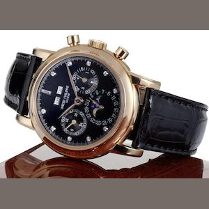 Patek Philippe. A very fine and very rare 18ct rose gold and diamond black dial manual wind perpetual calendar chronograph wristwatch together with fitted Patek Philippe box, setting tool and Extract from Archives Ref:3971E, Case No.2870012, Movement No.875483, Made 1989, Sold January 18th, 1990