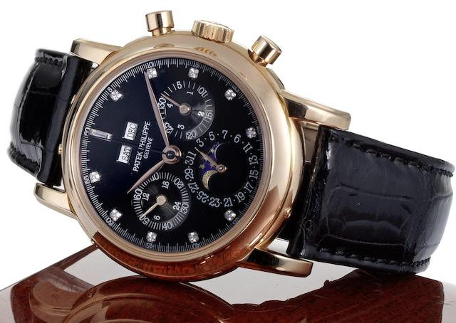 Patek Philippe. A very fine and very rare 18ct rose gold and diamond black dial manual wind perpetual calendar chronograph wristwatch together with fitted Patek Philippe box, setting tool and Extract from ArchivesRef:3971E, Case No.2870012, Movement No.875483, Made 1989, Sold January 18th, 1990