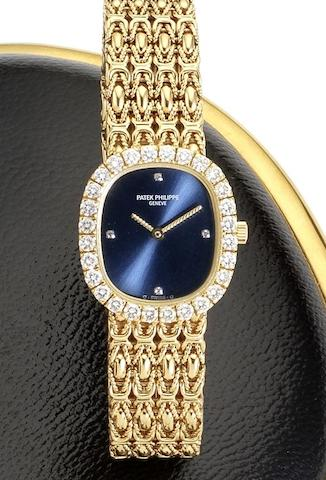 Patek Philippe. A lady's 18ct gold and diamond set bracelet watch together with Certificate of Origin Ellipse, Ref:4734/001, Movement No. 1608872, Sold 10th August 1990