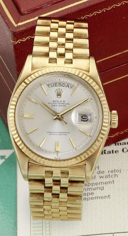 Rolex. An 18ct gold automatic calendar bracelet watch together with original fitted box, chronometer certificate and bookletsDay-date, Ref:1803, Case No.927441, Sold 1st October 1964,