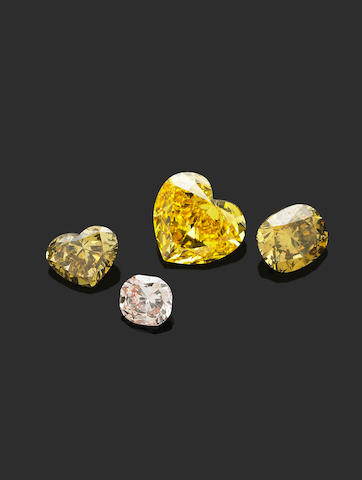 An unmounted 1.04 carat fancy vivid yellow diamond