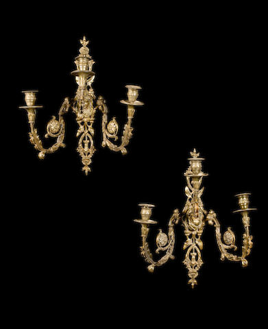 A pair of late 19th century gilt bronze wall lights