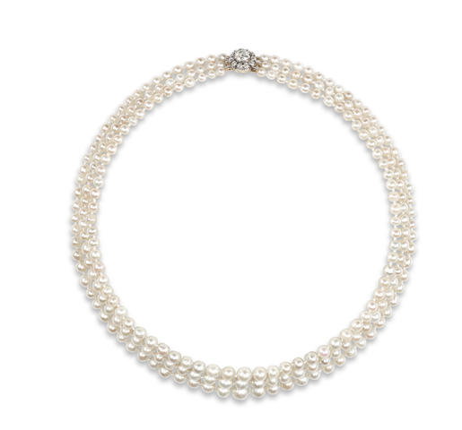 A three-row natural pearl necklace to a late 19th century diamond cluster clasp