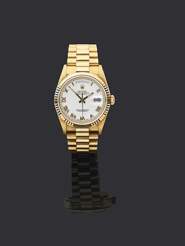 Rolex. An 18ct gold automatic calendar bracelet watch