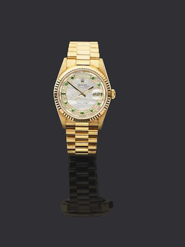 Rolex. An 18ct gold automatic calendar bracelet watch
